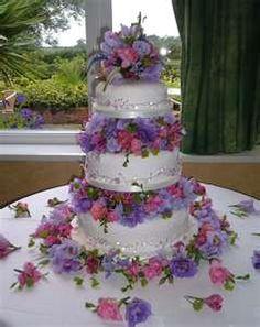 Three tier wedding cake and flowers. (Wedding Cakes)