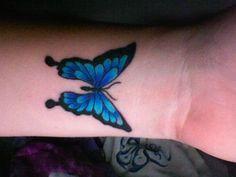 she wears a butterfly on her wrist...
