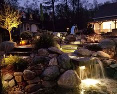 Low voltage Landscape lighting in a water feature by Bahler Brothers in Connecticut