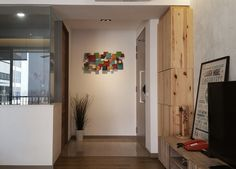 RSDS Architects - Singapore interior design renovation - apartment entrance foyer with wall art and spot light
