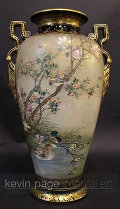 A large Japanese Satsuma vase decorated with ducks signed Kinkozan