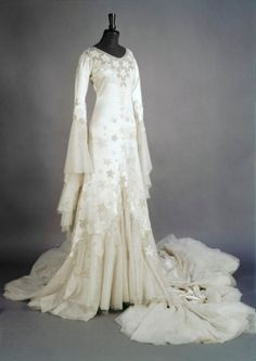 1933 Norman Hartnell Wedding dress worn by Margaret Whigham. Embroidered with stars and with an extra wide train for the Brompton Oratory where she was married. Via Victoria and Albert Museum Collection, London.