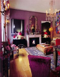 dark plummy rooms - Isabella Blow's purple living room with red accents by Camilla Guiness - WOI via Atticmag
