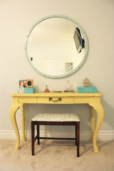 Love that vanity table so much....maybe a different color though