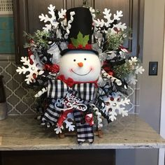 Snowman Wreath, Christmas wreath, Christmas decor, Christmas decorations, black and white ribbon Supplies could slightly change with availability. Snowman Christmas Decorations, Snowman Wreath, Christmas Door, Christmas Centerpieces, Christmas Snowman, Christmas Holidays, Snowman Crafts, Christmas Trees, Christmas Movies