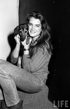 Young Brooke Shields and a dachshund