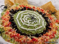 Need some eerie eats for your Halloween bash? Get tangled up in our creepy-crawly Spiderweb Spread by dipping and dunking your favorite chips into this zesty south-of-the-border party spread that guarantees a web of excitement in every bite. Halloween Snacks, Recetas Halloween, Halloween Dinner, Holidays Halloween, Happy Halloween, Halloween Finger Foods, Halloween Parties, Halloween Spider, Halloween Stuff