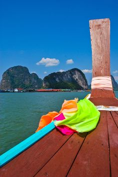 Phang Nga Bay, Thailand - Cruising the limestone cliffs of the bay by longtail boat past the floating village of Koh Panyee on the way to James Bond Island
