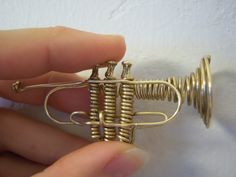 Miniature trumpet made from one piece of wire. Took about 2+ hours to make. Check out my other wire instrument: French Horn: Tuba: Trombone: