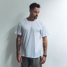 Simple, stylish and comfortable. The perfect tee for every occasion. A regular fit t-shirt that looks good worn on its own or layered. This versatile t-shirt features a 2cm ribbed neck line.  cotton rayon blend Regular fit Ribbed neck White  Cool wash, hang dry  Model wears size XL Xl Models, Best Wear, That Look, Label, Stylish, Tees, Simple, Fitness, Mens Tops