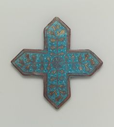 Cross-Shaped Tile Object Name: Cross-shaped tile Date: second half 13th–early 14th century Geography: Iran Culture: Islamic Medium: Stonepaste; overglaze painted and leaf gilded (lajvardina) Dimensions: H. 8 3/8 in. (21.3 cm) D. 5/8 in (1.6 cm) Classification: Ceramics-Tiles
