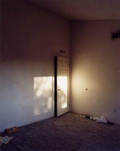 """Todd Hido - """"Hido's photographs reveal isolation and anonymity in contemporary suburbia. Eerily lit rooms and suddenly abandoned homes increase the effect of loneliness and loss."""""""