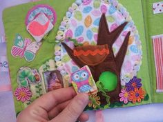 Quiet book page with lots of texture, photo of baby and bird and owl attached with ric rac