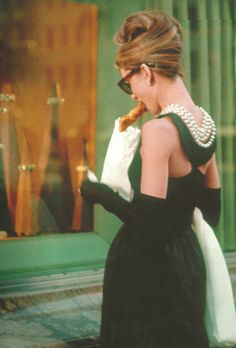 "Audrey Hepburn in ""Breakfast At Tiffany's"", 1961. She did not want to eat a danish in this scene; instead she wanted to hold an ice cream cone. The danish ""won"" since she was supposed to be having *Breakfast* at Tiffanys."