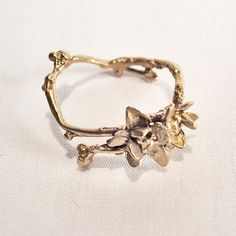 I'm madly in love with all these delicate, organic rings I keep seeing. And I don't even wear rings.