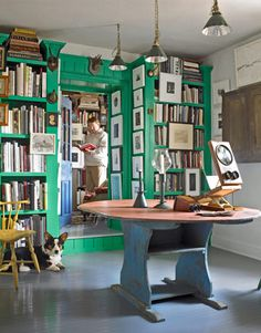 Le-Le the Corgi hangs out in this bright green library.