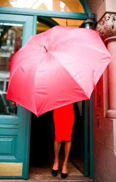 red pencil skirt and giant pink umbrella