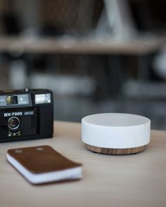 Orèe Pebble - wireless charging & speakers made from marble and wood