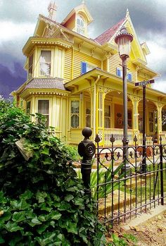 A yellow Victorian house.