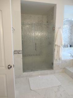 Installed shower doors. Visit Showroom Partners online for hundreds of home improvement ideas.
