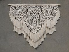 Large macrame wall hanging Color: off-white. Material: unbleached cotton rope, wood. Length of the wood is approx 100 cm (39 inches); macrame canvas is approx max 84 cm (33 inches) long. More macrame wall hangings https://www.etsy.com/shop/PapuShoi?section_id=19482238 If you have any