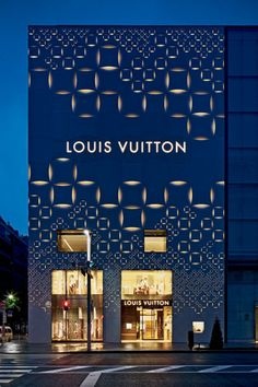 Echoing the client's signature checkered motif, Aoki's facade wraps the corner of an existing department store with a textured opalescent surface that transforms into an elegant light box after dark.