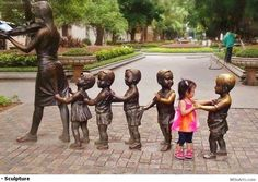 An awesome shot of a child who getting closer to another child but made of bronze. www.WOoArts.com