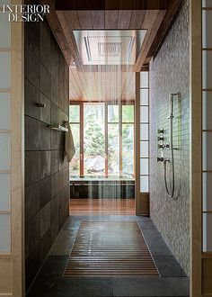 Capturing the Great Outdoors: A Japanese Bathhouse in the Mountains of Montana by CTA and Envi Design   A shower runs between the changing room and soaking tub
