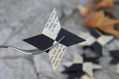origami ninja stars . solid black & book page