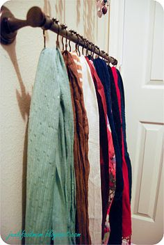 Towel rack and shower curtain hooks to organize scarves