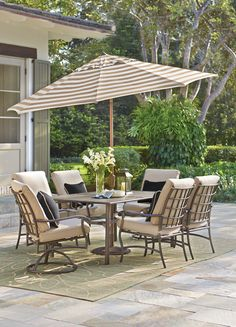 Dine in style with our Gabriel 7-Piece Outdoor Dining Set. This set includes a dining table, four standard dining chairs and two swivel rocker dining chairs. The espresso bronze finish is complemented by beige, welted olefin fabric cushions with velcro back ties. The table top is planked with one umbrella hole. Shop at Home Decorators Collection.