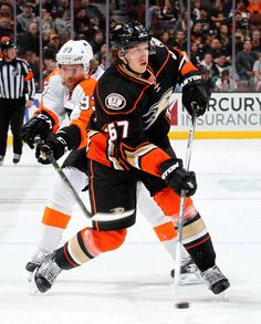 Rickard Rakell #67 of the Anaheim Ducks handles the puck during the game against the Philadelphia Flyers on December 27, 2015 at Honda Center in Anaheim, California.