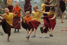 Young monks in Tibet dancing and having fun