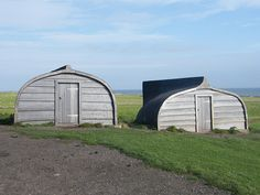 These boats are on Lindisfarne (Holy Island), the fishermen have a great way to recycle their old boats by turning them upside down and creating sheds.