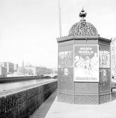 Ireland news of the world, pisspoir, A very ornate urinal on Ormond Quay, Dublin featuring a poster ad for the News of the World. Photographer: Elinor Wiltshire Date: 1969 Ireland Pictures, Old Pictures, Old Photos, Dublin Street, Dublin City, County Clare, Connemara, Dublin Ireland, Black And White Pictures