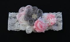 Vintage Inspired Delicate Flowers hair bow. This beautiful lace band is adorned with the most precious flowers, rhinestones and ribbon you have ever seen! See more 3LL Bows at threelittleladiesbowtique.com
