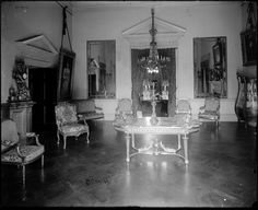 Monticello, Parlor, 1912.  The pair of gilded pier mirrors were shipped from France in 1790 and installed by Jefferson before 1809, concealing two half round niches remaining from the first version of Monticello.  The have only been removed once during the 20th century structural upgrade of Monticello.