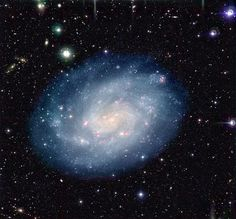 NGC 300 is a spiral galaxy that lies around 6.07 million light-years away from Earth in the southern constellation of Sculptor while it is receding from us at about 144 kilometers per second.  NGC 300 is a relatively diffuse spiral galaxy with a poorly defined core. Young hot blue stars dominate the outer spiral arms of the galaxy while the older stars congregate in the inner regions. Gases heated by hot young stars and shocks due to winds from massive stars and supernova explosions appear…