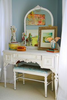 loving this vanity table & the art reflected in the mirror.