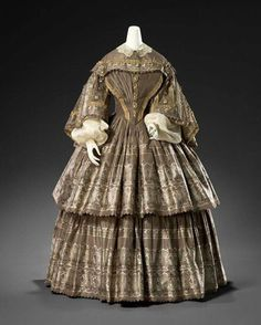 Carriage dress (c. 1855) English dress, Medium silk fabric with glass and metal buttons.