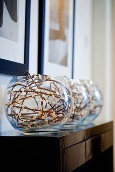 I Love this...pussy willow stems in glass bowl vases...Doing this spring from my tree!