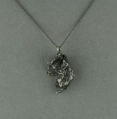 meteorite necklace pendant on oxidized silver chain - large. $125.00, via Etsy.