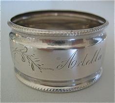 Ornate antique Sterling silver napkin ring engraved ADELLA