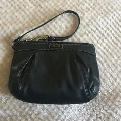 Coach wristlet! Black leather coach wristlet. Gently used. Slight makeup stain around inner lining. (Shown in picture). Coach Bags Clutches & Wristlets