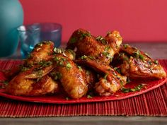 Rachael glazes Chicken Wings with a ginger-spiked Asian sauce for a truly unique flavor.