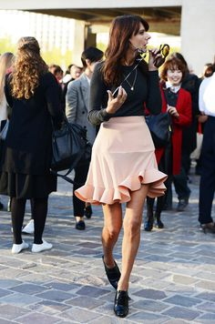 Love the feminine dusty pink ruffled skirt paired with the simple black top and more masculine shoes!