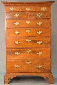 Seven drawer Chippendale walnut tall chest with large cornice molded top over faux three drawers over two short drawers over five drawers all on cut out bracket base, original brasses, Pennsylvania circa 1760.