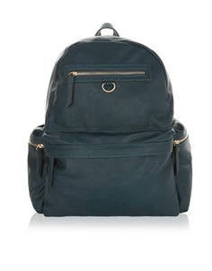 A stylish and practical piece, the Baxtor backpack has plenty of space for your everyday items. Its domed silhouette is finished with padded shoulder straps for comfort and a carry handle. You'll find two extra zipped compartments at the front of the bag, plus two zipped slip pockets at either side, adding extra storage to the main compartment. An interior zipped pocket is ideal for keeping small items separate. It's crafted with a subtly textured finish and stitch detail.