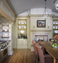 the millwork detail & fireplace make this a cozy kitchen...
