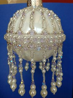 Veiled Beauty by Michelle Skobel--An idea on how to suspend a bracelet motif around the center of an ornament Beaded Ornament Covers, Beaded Ornaments, Ball Ornaments, Beaded Christmas Decorations, Diy Christmas Ornaments, Handmade Christmas, Theme Noel, Beaded Crafts, Idee Diy